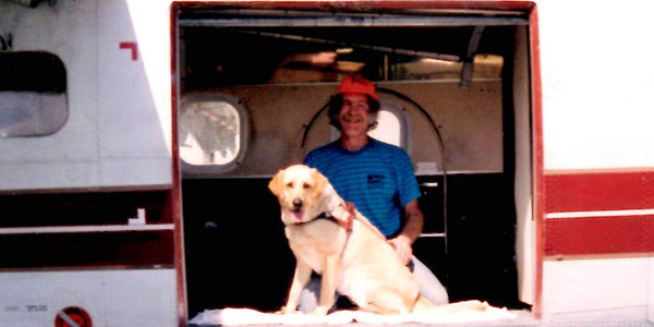 John and Kiowa in the door of an airplane.